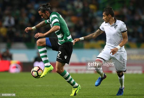 Sporting CP's defender Ezequiel Schelotto from Argentina with Vitoria Guimaraes' forward Raphinha in action during the Primeira Liga match between...