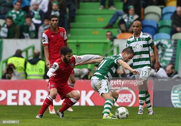 Sporting CP's defender Joao Pereira with SC Braga's forward Rafa Silva in action during the Primeira Liga match between Sporting CP and SC Braga at...