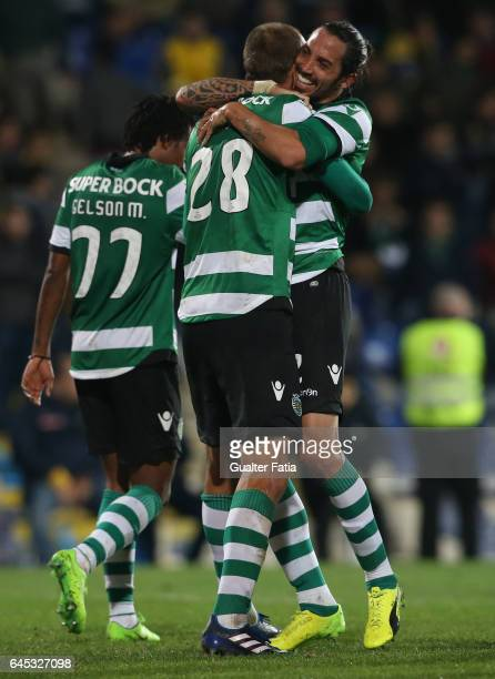 Sporting CP's forward Bas Dost from Holland celebrates with teammate Sporting CP's defender Ezequiel Schelotto from Argentina after scoring a goal...
