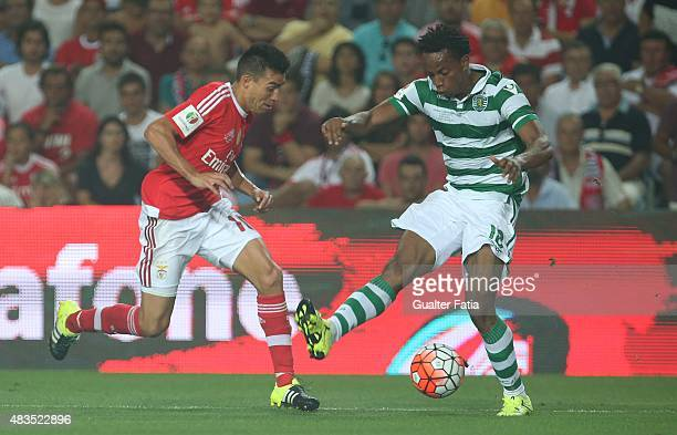 Sporting CP's forward Carrillo with SL Benfica's midfielder Nico Gaitan in action during the Portuguese Super Cup match between SL Benfica and...