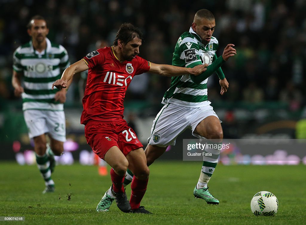 Sporting CP's forward from Algeria Islam Slimani with Rio Ave FC's defender Pedrinho in action during the Primeira Liga match between Sporting CP and Rio Ave FC at Estadio Jose Alvalade on February 8, 2016 in Lisbon, Portugal.