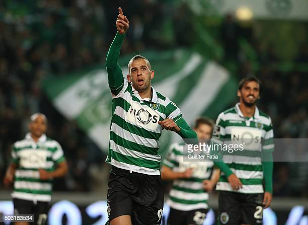 Sporting CP's forward Islam Slimani celebrates after scoring a goal during the Primeira Liga match between Sporting CP and FC Porto at Estadio Jose...