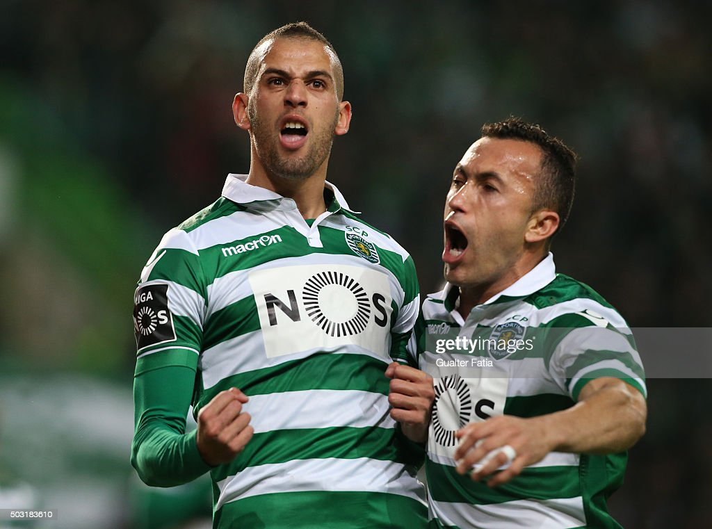 Sporting CP's forward <a gi-track='captionPersonalityLinkClicked' href=/galleries/search?phrase=Islam+Slimani&family=editorial&specificpeople=9704639 ng-click='$event.stopPropagation()'>Islam Slimani</a> celebrates with teammate Jefferson after scoring a goal during the Primeira Liga match between Sporting CP and FC Porto at Estadio Jose Alvalade on January 2, 2016 in Lisbon, Portugal.
