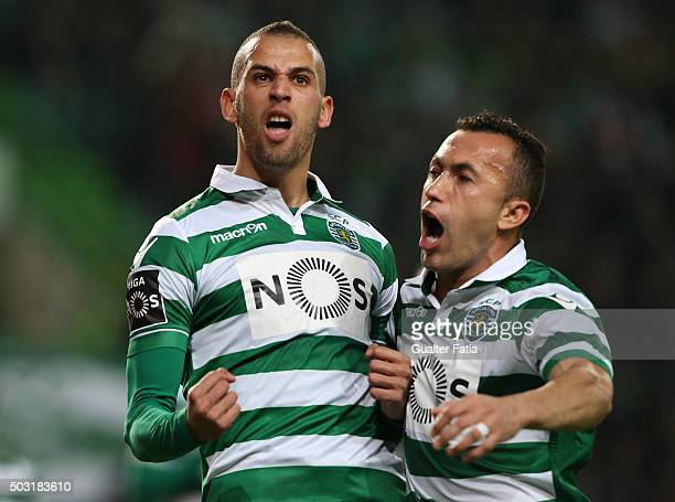 Sporting CP's forward Islam Slimani celebrates with teammate Jefferson after scoring a goal during the Primeira Liga match between Sporting CP and FC...