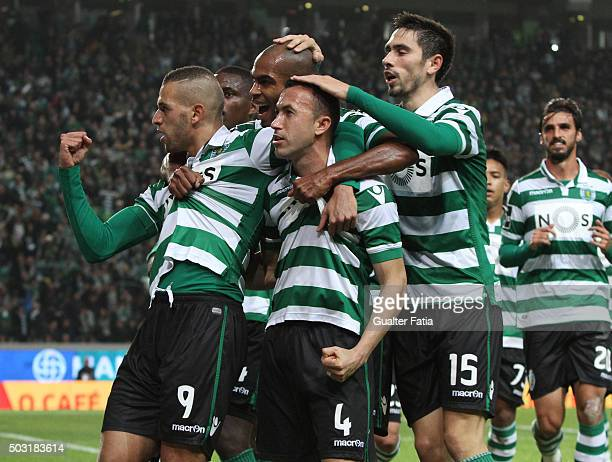 Sporting CP's forward Islam Slimani celebrates with teammates after scoring a goal during the Primeira Liga match between Sporting CP and FC Porto at...
