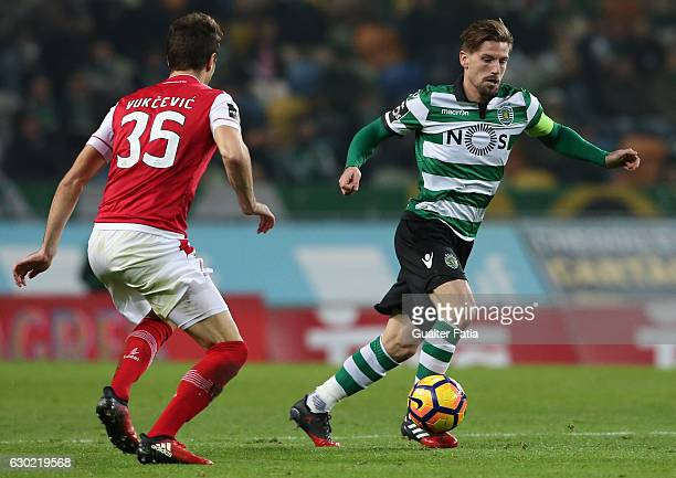 Sporting CP's midfielder Adrien Silva with Braga's midfielder Nikola Vukcevic from Montenegro in action during the Primeira Liga match between...