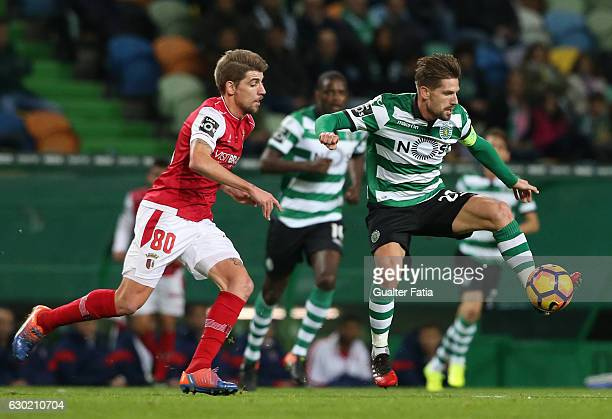 Sporting CP's midfielder Adrien Silva with Braga's midfielder Xeka from Portugal in action during the Primeira Liga match between Sporting CP and SC...