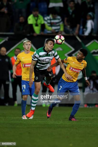 Sporting CP's midfielder Joao Palhinha from Portugal vies with Estoril's defender Ailton Silva from Brazil during the match between Estoril Praia SAD...