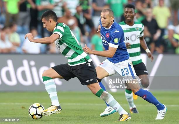 Sporting CPÕs midfielder Rodrigo Battaglia from Argentina with Belenenses's midfielder Hassan Yebda from Argelia in action during the PreSeason...
