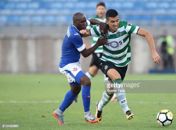 Sporting CP's midfielder Rodrigo Battaglia from Portugal with Belenenses's midfielder Tandjigora in action during the PreSeason Friendly match...