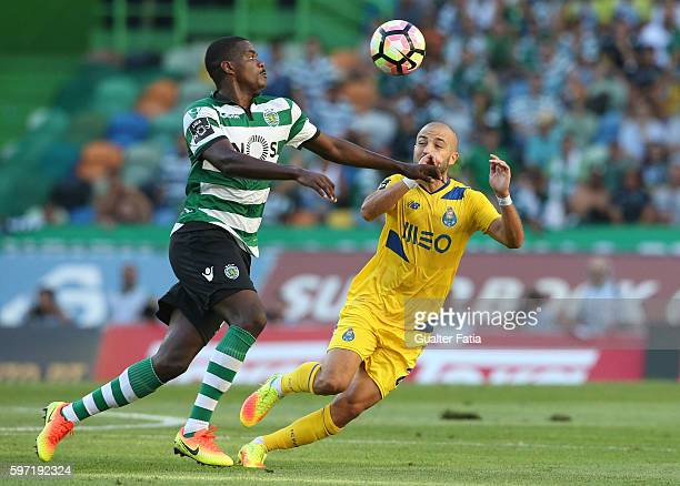 Sporting CP's midfielder William Carvalho with FC Porto's midfielder Andre Andre in action during the Primeira Liga match between Sporting CP and FC...