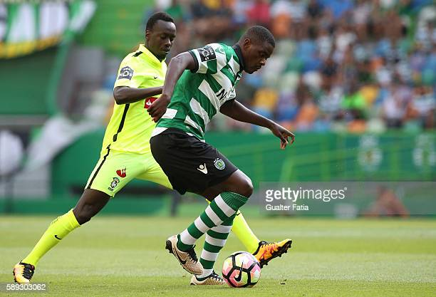Sporting CP's midfielder William Carvalho with CS Maritimo's forward Baba Diawara from Cameroon in action during the Primeira Liga match between...