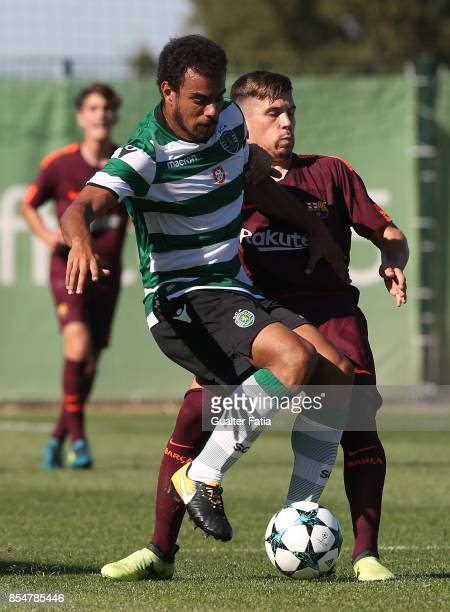 Sporting CP's Pedro Ferreira with FC Barcelona Carles Perez in action during the UEFA Youth League match between Sporting CP and FC Barcelona at CGD...