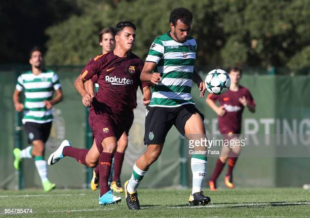 Sporting CP's Pedro Ferreira with FC Barcelona Juan Fernandez in action during the UEFA Youth League match between Sporting CP and FC Barcelona at...