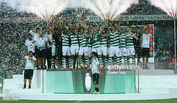Sporting CP's players celebrating receving the portuguese Surpercup trophy during the Portuguese Super Cup match between SL Benfica and Sporting CP...