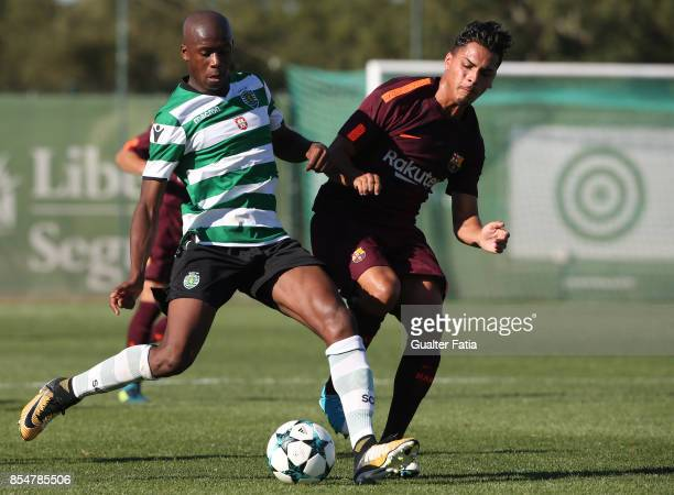 Sporting CP's Tiago Djalo with FC Barcelona Juan Fernandez in action during the UEFA Youth League match between Sporting CP and FC Barcelona at CGD...