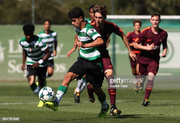 Sporting CP's Tomas Silva with FC Barcelona Miranda in action during the UEFA Youth League match between Sporting CP and FC Barcelona at CGD Stadium...