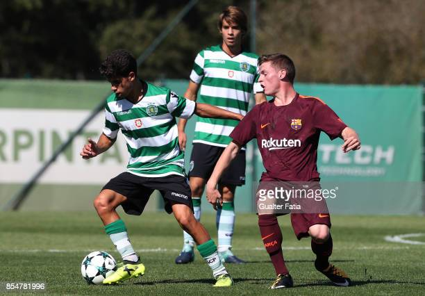 Sporting CP's Tomas Silva with FC Barcelona Sergio Gomez in action during the UEFA Youth League match between Sporting CP and FC Barcelona at CGD...