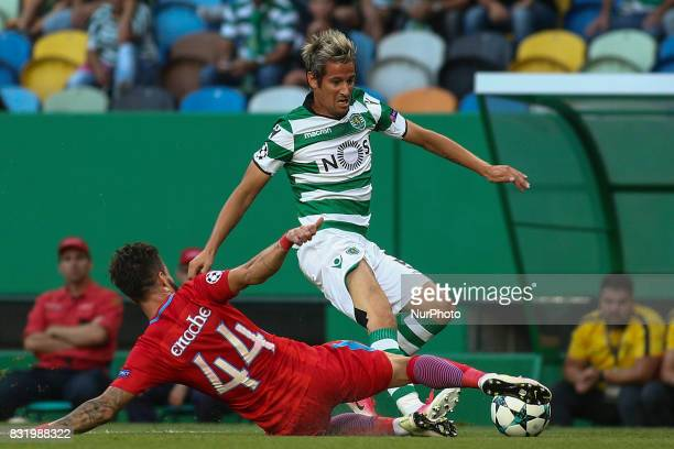 Sporting defender Fabio Coentrao vies with Steaua Bucuresti defender Gabriel Enache during the UEFA Champions League football match between Sporting...
