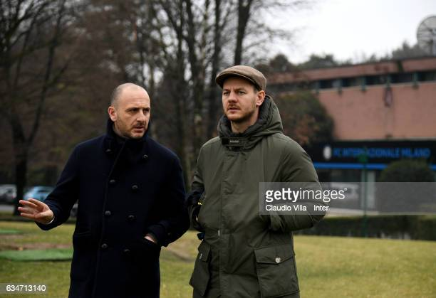 Sporting Director FC Internazionale Piero Ausilio and Alessandro Cattelan chat prior to the training session at Suning Training Center at Appiano...