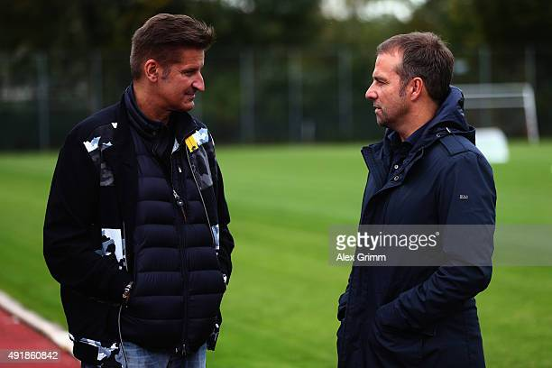 DFB sporting director HansDieter Flick and German singer Hartmut Engler chat during their visit at the FV Ingersheim sports ground to celebrate the...
