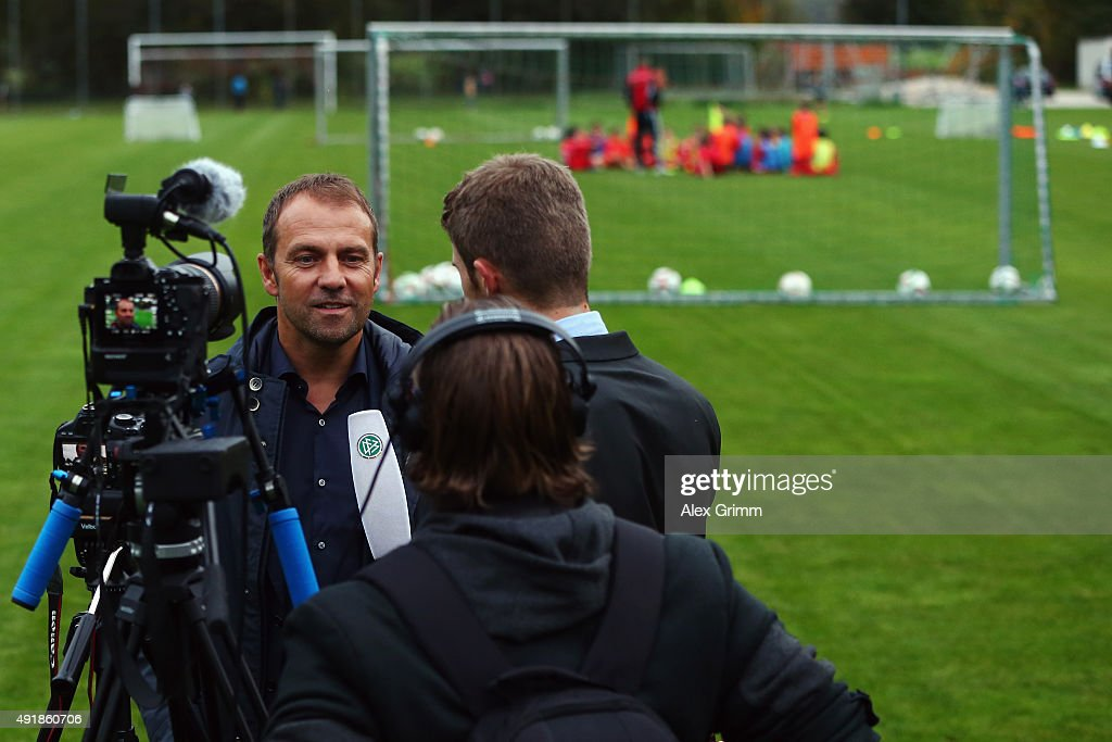 DFB sporting director <a gi-track='captionPersonalityLinkClicked' href=/galleries/search?phrase=Hans-Dieter+Flick&family=editorial&specificpeople=2439902 ng-click='$event.stopPropagation()'>Hans-Dieter Flick</a> talks to the media during his visit at the FV Ingersheim sports ground to celebrate the attendance of the 150.000th football coach at the DFB Mobil visit on October 8, 2015 in Ingersheim, Germany.