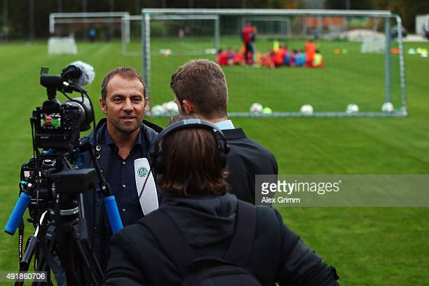DFB sporting director HansDieter Flick talks to the media during his visit at the FV Ingersheim sports ground to celebrate the attendance of the...