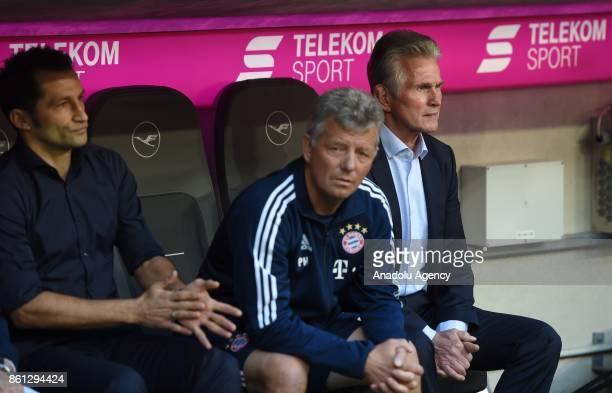 Sporting director Hasan Salihamidzic assistant coach Peter Hermann and head coach Jupp Heynckes of FC Bayern Munich look on during the Bundesliga...