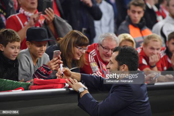 Sporting director Hasan Salihamidzic of FC Bayern Muenchen signs autographs prior to the UEFA Champions League group B match between Bayern Muenchen...