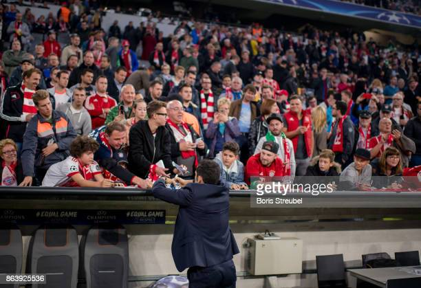 Sporting director Hasan Salihamidzic sign autographs prior to the UEFA Champions League group B match between Bayern Muenchen and Celtic FC at...