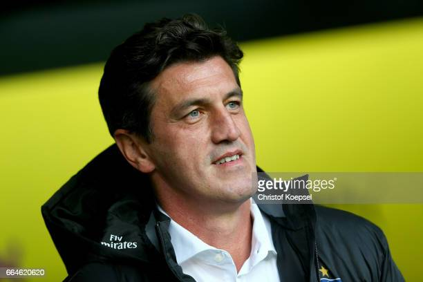 Sporting director Jens Todt of Hamburg is seen during the Bundesliga match between Borussia Dortmund and Hamburger SV at Signal Iduna Park on April 4...
