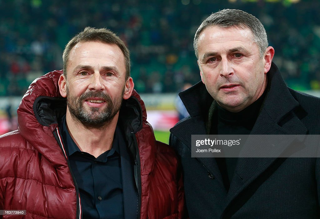 Sporting director <a gi-track='captionPersonalityLinkClicked' href=/galleries/search?phrase=Klaus+Allofs&family=editorial&specificpeople=634763 ng-click='$event.stopPropagation()'>Klaus Allofs</a> (R) of Wolfsburg and his brother Thomas Allofs, member of the board of Duesseldorf are seen prior to the Bundesliga match between VfL Wolfsburg and Fortuna Duesseldorf 1895 at Volkswagen Arena on March 15, 2013 in Wolfsburg, Germany.