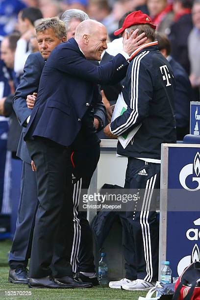 Sporting director Matthias Sammer and assistant coach Hermann Gerland celebrate after winning 20 the Bundesliga match between FC Schalke 04 and FC...