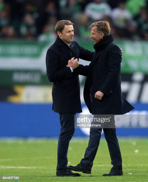 Sporting director Olaf Rebbe and head coach Andries Jonker of Wolfsburg shake hands after the Bundesliga match between VfL Wolfsburg and SV Darmstadt...