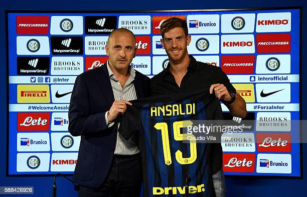 Sporting Director Piero Ausilio and Cristian Ansaldi pose for a photo during the FC Internazionale press conference at the club's training ground at...