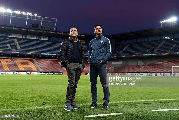 Sporting Director Piero Ausilio and Vice President Javier Zanetti chat during the FC Internazionale training session at Generali Stadium on September...