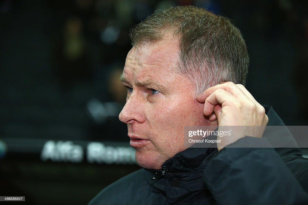 Sporting director Stefan Reuter of Augsburg looks on prior to the Bundesliga match between Eintracht Frankfurt and FC Augsburg at Commerzbank Arena...