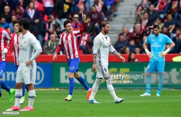 Sporting Gijon's Croatian forward Duje Cop celebrates after scoring a goal during the Spanish league football match Real Sporting de Gijon vs Real...