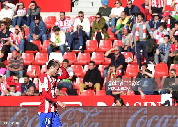 Sporting Gijon's forward Ismael Lopez gestures after Villarreal's third goal during the Spanish league football match Real Sporting de Gijon vs...