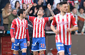 Sporting Gijon's Paraguayan forward Sanabria celebrates a goal next to Sporting Gijon's forward Carlos Castro during the Spanish league football...