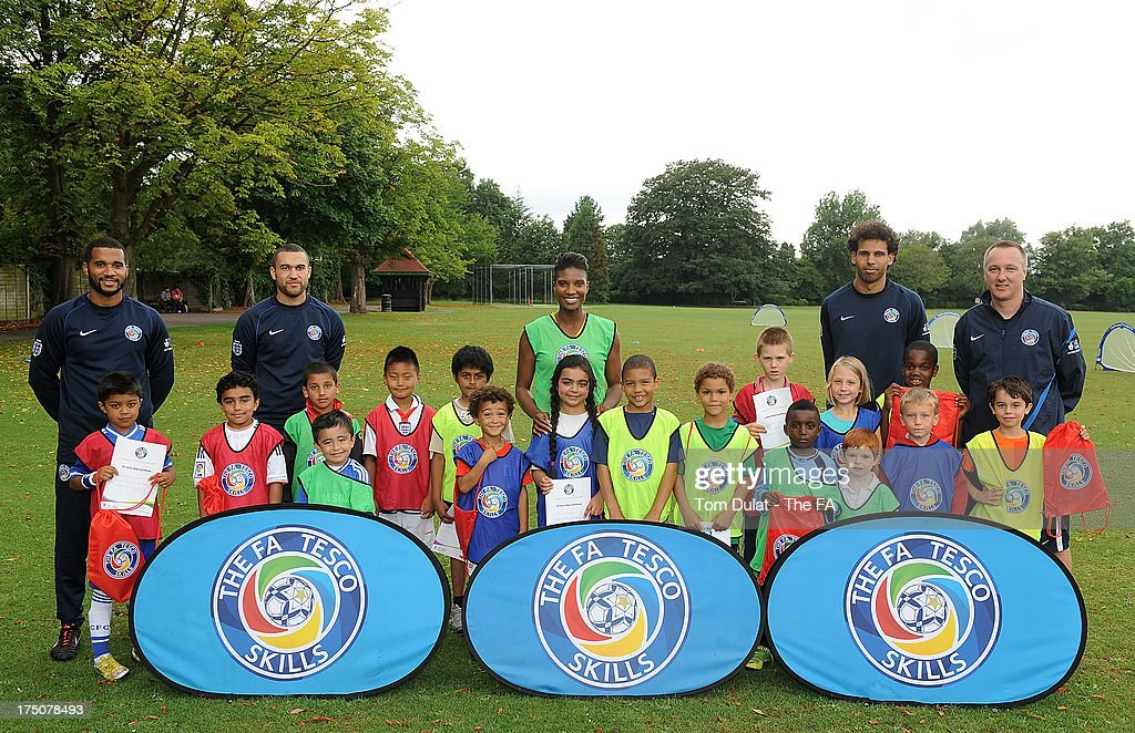 Sporting icon <a gi-track='captionPersonalityLinkClicked' href=/galleries/search?phrase=Denise+Lewis&family=editorial&specificpeople=211595 ng-click='$event.stopPropagation()'>Denise Lewis</a> supports The FA Tesco Skills programme which provides children opportunities to get into football with first class coaching poses for photos at St Marys Recreation Ground on July 31, 2013 in Harrow, England.