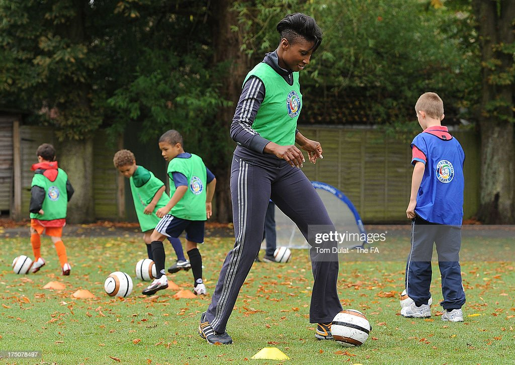 Sporting icon <a gi-track='captionPersonalityLinkClicked' href=/galleries/search?phrase=Denise+Lewis&family=editorial&specificpeople=211595 ng-click='$event.stopPropagation()'>Denise Lewis</a> supports The FA Tesco Skills programme which provides children opportunities to get into football with first class coaching, participates in a training session at St Marys Recreation Ground on July 31, 2013 in Harrow, England.