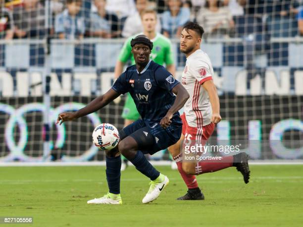 Sporting Kansas City Defender Ike Opara shields the ball away from Atlanta United FC Forward Hector Villalba during the match between Sporting Kansas...