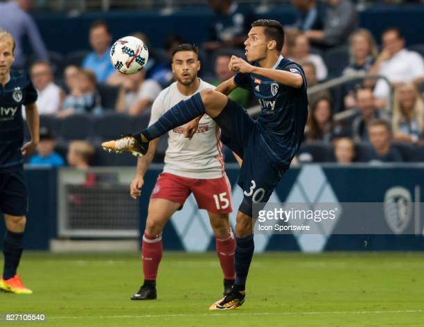 Sporting Kansas City Forward Daniel Salloi gains control of the ball away from Atlanta United FC Forward Hector Villalba during the match between...