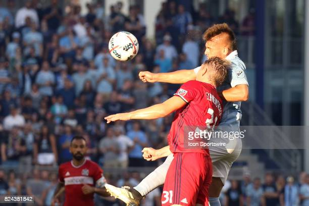 Sporting Kansas City forward Diego Rubio and Chicago Fire midfielder Bastian Schweinsteiger fight for a header in the first half of an MLS match...