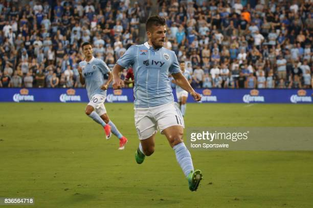 Sporting Kansas City forward Diego Rubio tries to run a ball down in the corner during the first half of an MLS match between FC Dallas and Sporting...