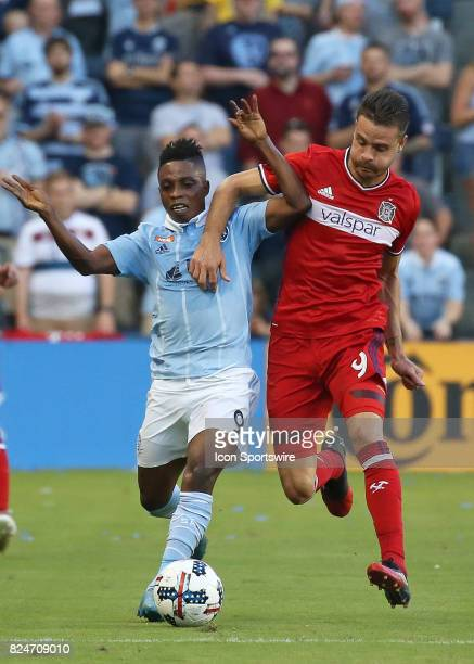 Sporting Kansas City forward Latif Blessing and Chicago Fire forward Luis Solignac fight for the ball in the first half of an MLS match between the...