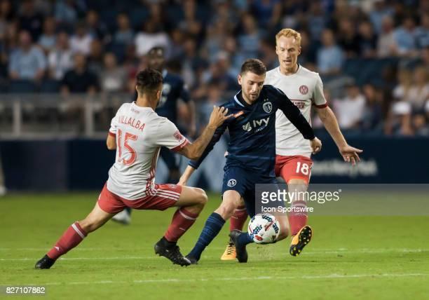 Sporting Kansas City Midfielder Ilie Sanchez splits the defense of Atlanta United FC Forward Hector Villalba and Atlanta United FC Midfielder Jeff...