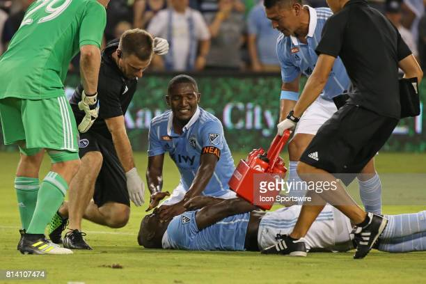 Sporting Kansas City midfielder Jimmy Medranda and the medical staff attend to defender Ike Opara in the first overtime of the US Open Cup...