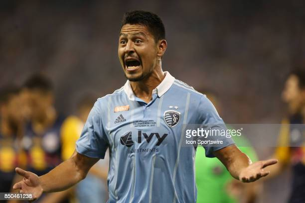 Sporting Kansas City midfielder Roger Espinoza complains about a call in the first half of the Lamar Hunt US Open Cup final between the New York Red...